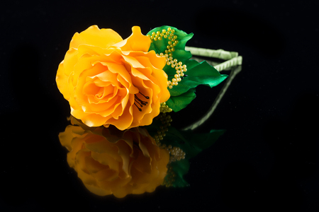 hair band: Yellow flower hair band handmade decoration on black background