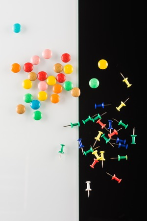 push in pins: set of color push pins on white and black background