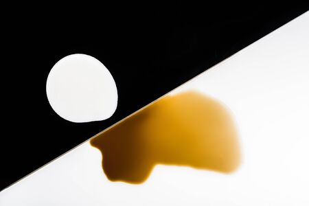 overturn: brown and white coffee and milk blots on white and black background