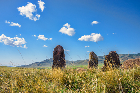 megaliths: Landscape of megalithic rocks on the green field in sunny day