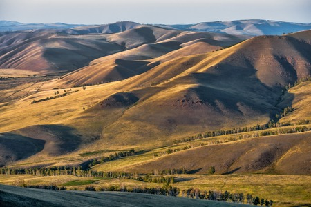 green hills: Beautiful landscape with green hills at sunset Stock Photo