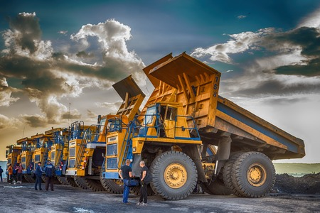 worksite: Big yellow mining trucks at worksite Editorial