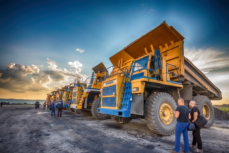 Big yellow mining trucks at worksite Editorial
