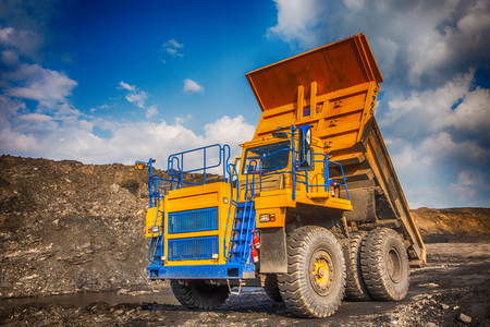 worksite: Big yellow mining truck at worksite