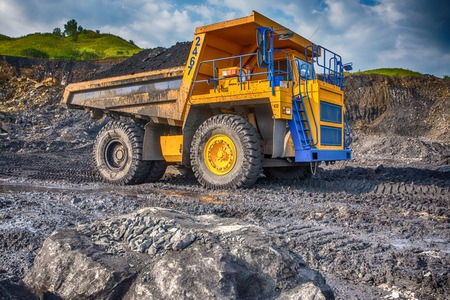 earthmover: Big yellow mining truck at worksite