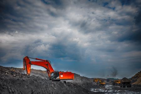 worksite: NOVOKUZNETSK, RUSSIA - JULY 26, 2016 Big orange excavator at worksite