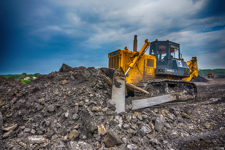 camion minero: NOVOKUZNETSK, RUSSIA - JULY 26, 2016: Big yellow mining truck at worksite