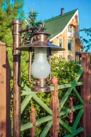 Vintage lantern and wooden fence