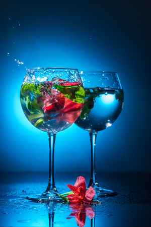 wineglasses with water and flowers Stock Photo