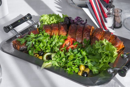 celebration dish with parsley on metal tray
