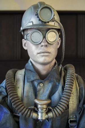 mannequin on miner equipment Stock Photo