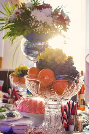 fruits and flower bouquet in glass vases