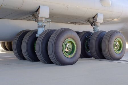 The chassis of a cargo aircraft on the airport strip. Stock Photo