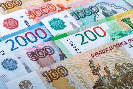 Background of various paper banknote. Russian money in nominals 100, 500, 1000, 2000, 5000 rubles.