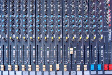 Closeup part of professional digital audio mixer console.