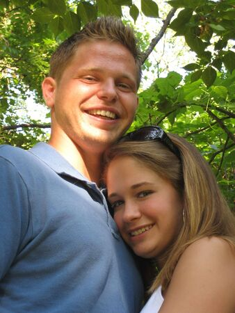 Girlfriend resting her head on her boyfriend's chest photo