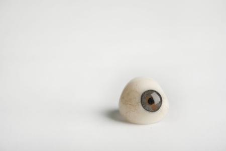 prosthetic: Glass prosthetic eye on white background Stock Photo