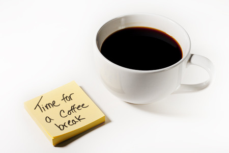 Cup of coffee, yellow sticky note indicating Time for a Coffee Break