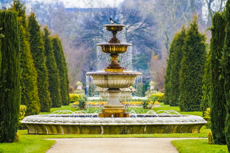 water feature: Elegant Fountain With Dripping Water in Regent\ Stock Photo