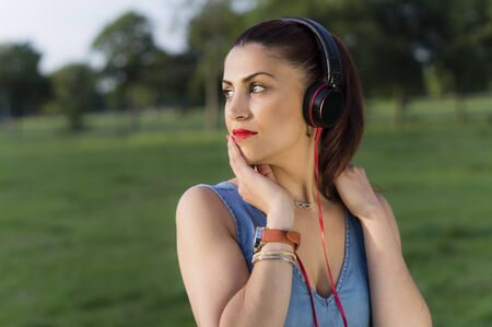 Woman with Headphones in the Park photo