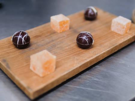 Passion Fruit Tart & Chi Chocolate Dessert Pieces on Wood photo