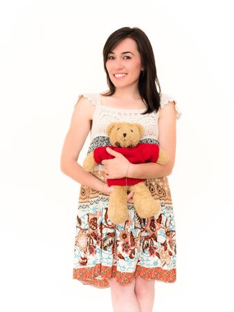the young animal: Pretty Smiling Young Female Embrace the Teddy Toy Isolated on White Background