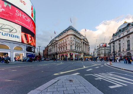 tdk: Piccadilly Circus street view on July 28, 2015 in London, UK. Built in 1819, it is the major shopping, entertainment areas and key tourist attractions in London.
