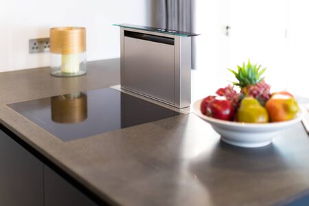 granit: Downdraft Cooker Hood, Stainless Steel and Electronic Hob on Granit Countertop