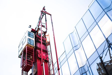 Red Crane and Glass Office Building with Skyline Stock fotó