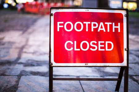 Red Footpath Closed Sign Warning on Road