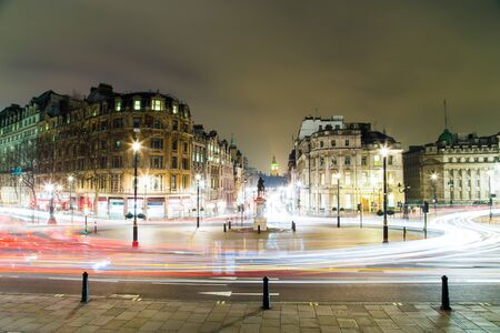 Trafalgar Square at Night in London with Lights and Car Trail Motion