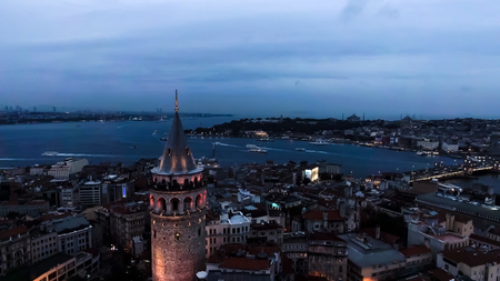 Galata Tower Aerial Urban View Photo feat. Istanbul Skyline and Cityscape with Goldenhorn Bosphorus at Night Stock Photo