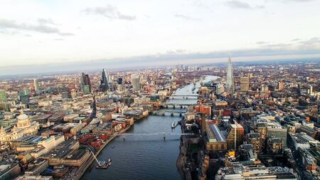 Aerial View of the Iconic Landmarks which crosses the River Thames in London feat. City of London Famous Skyscrapers and St Pauls Cathedral Financial District