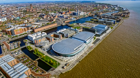 Aerial View of Liverpool City Photo with Docks, Wheel, Modern Buildings feat. Liverpool Cathedral and Mersey River on a Sunny Day in England Stock Photo