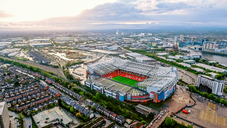 Old Trafford is a football stadium Greater Manchester England and the home of Manchester United. Aerial View of Iconic Football Ground in United Kingdom