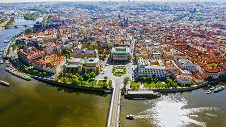 Aerial Bird Eye View of Prague Center Old Town Cityscape in Czech Republic feat. Vltava River and Boats on a Sunny Day