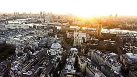 Panoramic Aerial View of Houses of Parliament Big Ben Icon in Central London features The London Eye Wheel, River Thames and Iconic Business Buildings Skyscrapers with Beautiful Sunrise Stock fotó