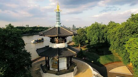 Aerial View Battersea Park and Peace Pagoda Temple in London. Thames River and Peace Pagoda Buddhist Temple on a Sunny Day