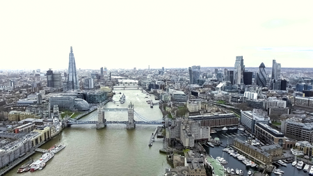 Aerial View Iconic Landmarks and Cityscape of London feat. Tower Bridge, Tower of London, City Hall, River Thames, The Shard Building, City of London Financial District and Skyscrapers in 4K UHD