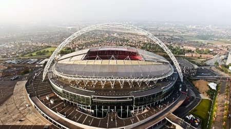 Aerial View of Iconic Football and Events Landmark Wembley Stadium, Soccer Arena Flying By Drone Shot in London England
