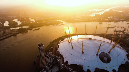 Aerial View Image Photo Flying by London O2 Arena Concert Hall by the River Thames Waterway at Sunrise Dawn Time feat. Amazing Sky 4K Ultra HD