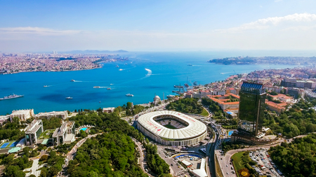 New Istanbul Skyline Cityscape Aerial View of Beautiful Bosphorus feat. Iconic Landmark Dolmabahce Palace, Mosque and Besiktas Football Stadium Arena in Turkey Stock Photo