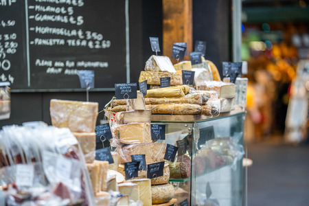 LONDON, UK - NOVEMBER 13, 2018 - Cheese and other quality Italian products such as Salami at Londons famous markets located near the Borough Market