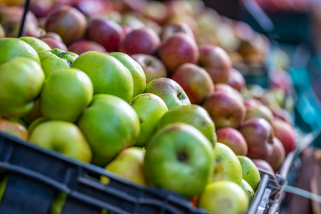 Fresh Green and Various Apples in a Market with Close Up Bokeh Background