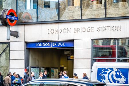 LONDON - NOVEMBER 13 : Entrance to London Bridge underground station. The red circular logo with the outdoor on 13 November 2018 in London, England UK Sajtókép