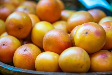 Fresh oranges in local market. Selected close up focus.