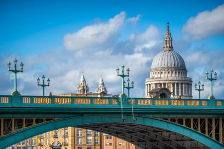 View of the iconic St. Pauls Cathedral over Southwark Bridge, London, UK