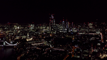Aerial London City View feat. New Modern Office and Business Buildings Lights in the Financial District at Night