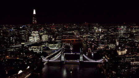Beautiful Panoramic Night Aerial View of New London Cityscape and Landmarks around Tower Bridge and Thames River feat. Famous Skyscrapers