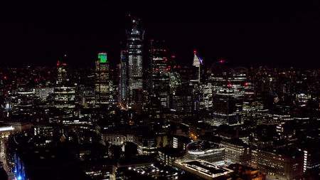 Aerial View of Urban City at Night. Modern High Rise Buildings and Office Towers in Business and Financial District. High Up Shot of London City Skyscrapers Lit Brightly Banque d'images